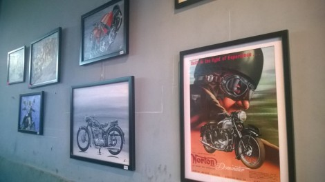 All walls are adorned by frames pictures of classics and legends.